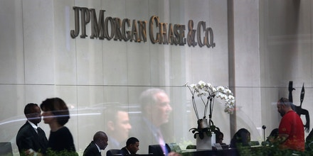 NEW YORK, NY - JULY 13:  People are reflected in the window of the headquarters of JPMorgan Chase on Park Avenue in midtown Manhattan on July 13, 2012 in New York City. The bank, which reported its second-quarter results on Friday, disclosed that the losses on a credit bet could mount to more than $7 billion, as the nation's largest bank indicated that traders may have intentionally tried to conceal the extent of the loss. JPMorgan also said Friday that it would be forced to restate its first-quarter results.  (Photo by John Moore/Getty Images)