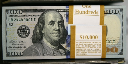 WASHINGTON, DC - MAY 20:  Newly redesigned $100 notes lay in stacks at the Bureau of Engraving and Printing on May 20, 2013 in Washington, DC. The one hundred dollar bills will be released this fall and has new security features, such as a duplicating portrait of Benjamin Franklin and microprinting added to make the bill more difficult to counterfeit.  (Photo by Mark Wilson/Getty Images)