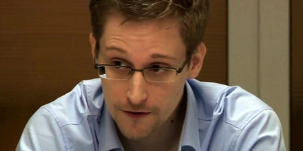MOSCOW, RUSSIA - OCTOBER 31:  NSA whistleblower Edward Snowden during a meeting with German Green Party MP Hans-Christian Stroebele (not pictured) regarding being a witness for a possible investigation into NSA spying in Germany, on October 31, 2013 in Moscow, Russia. There has been calls in Germany for an investigation into alledged US spying in Germany, which reportedly could include the tapping of German chancellor Angela Merkel's phone. (Photo by Sunshinepress/Getty Images)