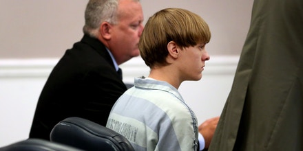 CHARLESTON, SC - JULY 16:  Dylan Roof (C), the suspect in the mass shooting that left nine dead in a Charleston church last month, appears in court accompanied by assistant defensive attorney William Maguire July 18, 2015 in Charleston, South Carolina. The Associated Press, WCIV-TV and The Post and Courier of Charleston are challenging a judge's order issued last week that prohibits the release of public records in the June 17 shooting at Emanuel African Methodist Episcopal church.  (Photo by Grace Beahm-Pool/Getty Images)