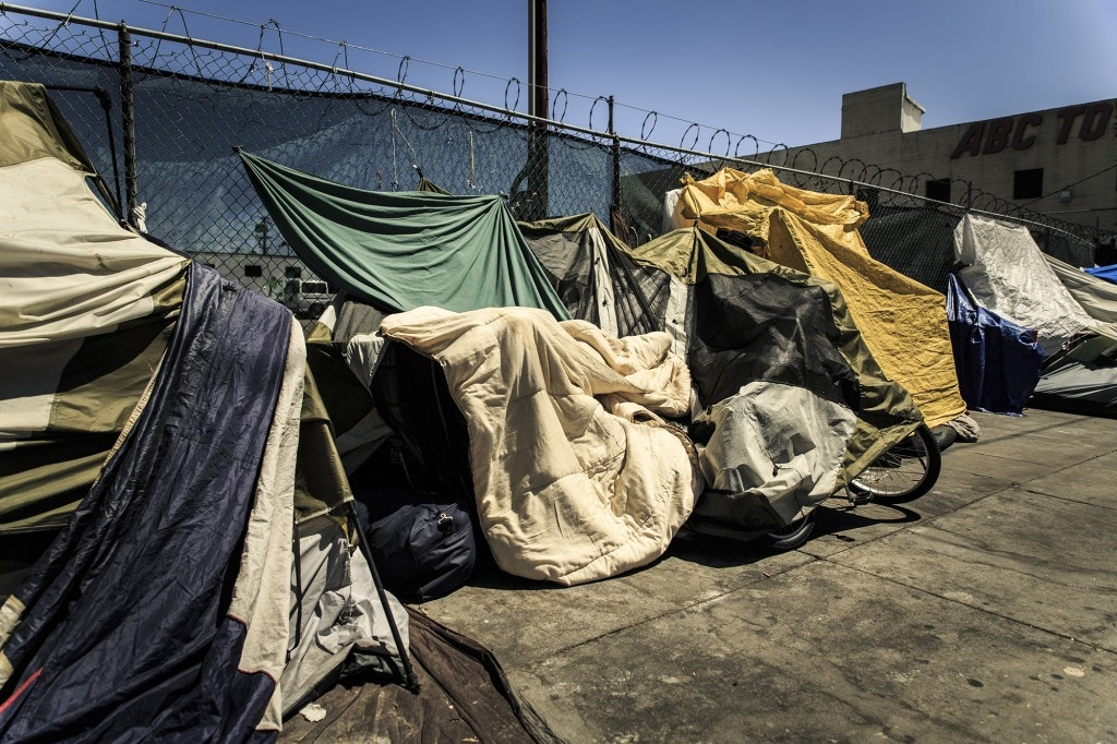 A block-long encampment running down San Pedro St houses a multitude of homeless people. Most of these people use tents makeshift plastic coverings and blankets to protect them from the often harsh summer L.A. weather.
