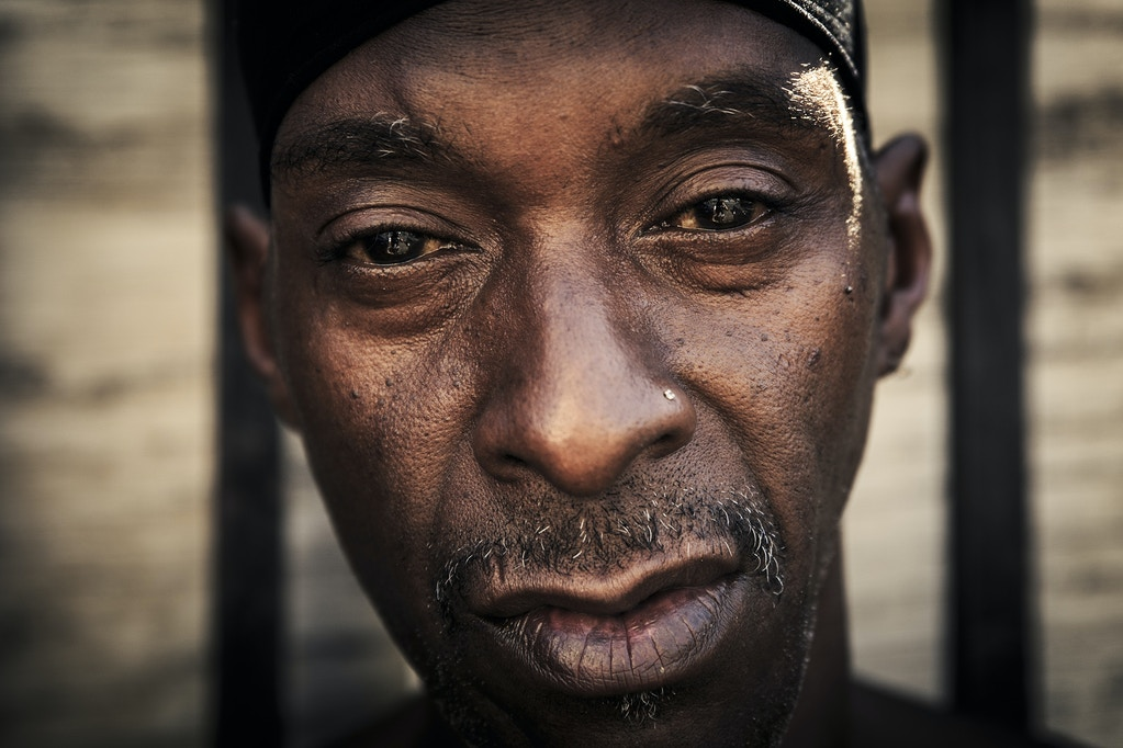 "Black, 47 years old, currently lives on 5th street. When asked about his situation as a homeless person, he explains ""These are good people. Of course, you gotta try to help yourself. Sometimes, you get lost out here. But as an individual, you gotta be able to help yourself still. I still wanna keep healthy. I still wanna try to do things and do better. But mentally, anybody can be mentally strained. A lot of people are not capable or competent of helping themselves. It could be periodic. One moment, I can be talking to you like this. And next thing you know, I can be going thru something totally different which I can't help myself. It's just the mental aspect. But you try to keep fighting, you try to get better"". He also admits that the biggest problem in the area is drugs, not just the ones that are sold illegally, but also the ones given to them by pharmaceutical companies."