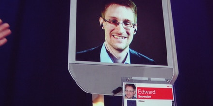 Former NSA contractor Edward Snowden appears by remote-controlled robot at a TED conference in Vancouver on March 18, 2014. Snowden emerged from his Russian exile in the form of a remotely-controlled robot to promise more sensational revelations about US spying programs. The fugitive's face appeared on a screen as he maneuvered the wheeled android around a stage at the TED gathering, addressing an audience in Vancouver without ever leaving his secret hideaway.     AFP PHOTO/Glen CHAPMAN        (Photo credit should read GLENN CHAPMAN/AFP/Getty Images)
