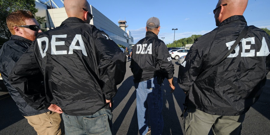 DEA agents wait for the arrival of Jamaican gang leader Christopher