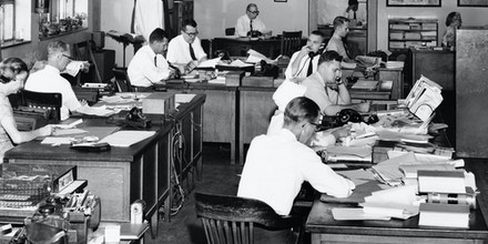 Office workers working in a press room