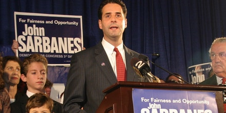 Democratic congressional candidate John Sarbanes, at podium, speaks as his father,  retiring Sen. Paul Sarbanes,D-Md., third from right, looks on, at an election night party in Baltimore, Md., Tuesday, Nov. 7, 2006. From left, are, John Sarbanes'   wife Dina, his  daughter Stephanie; 15 , his son Niko, 12, and son Leo, 7, front, next to podium.  (AP Photo/Timothy Jacobsen)