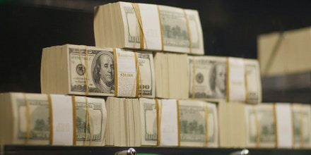 HOLLYWOOD, FL - MARCH 18:  Stacks of money are seen in what is being called a first-of-its-kind exhibit of five million dollars in cash at the Seminole Hard Rock Hotel & Casino on March 18, 2009 in Hollywood, Florida. The display consists of $100 bills encased in a 1,300-pound, custom-made $90,000 bullet-resistant Lexan showcase.  (Photo by Joe Raedle/Getty Images)