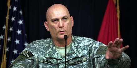** FILE ** Lt. Gen. Ray Odierno, the No. 2 U.S. military official in Iraq, briefs reporters in Baghdad in this Feb. 27, 2007 file photo.  Odierno said in an Associated Press interview Dec. 4 that he thinks 15-month tours are too long, although he said soldiers are bearing up well.  (AP Photo/Maya Alleruzzo, File)