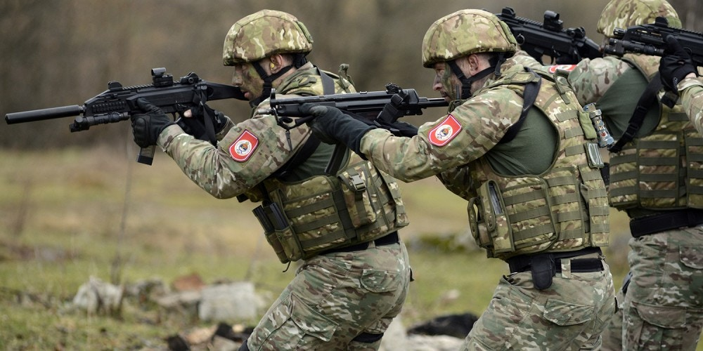Special Police Units of the Republika Srpska participate in a tactical demonstration at the training center Manjaca near western Bosnian town of Banja Luka, 260 kms west of Sarajevo , Bosnia, on  Wednesday, March 25, 2015. Ten soldiers from U.S. Special Operations Command Europe, 18 police officers from the Police Forces of  the Federation of Bosnia Herzegovina and 18 from the Police Forces of  the Republic of Srpska trained and lived together for a month and conclude their training with this exercise. The month-long Joint Combined Exchange Training (JCET) program provides U.S. Special Operations Forces a chance to train with colleagues in partner nations to develop their military tactics and skills in unfamiliar settings, while also improving bilateral relations and interoperability with partner nation forces. (AP Photo/Radivoje Pavicic)