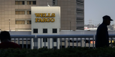 Wells Fargo & Co. signage is displayed on a parking garage in downtown Los Angeles, California, U.S., on Tuesday, July 7, 2015. Wells Fargo & Co. is scheduled to report quarterly earnings on July 14. Photographer: Patrick T. Fallon/Bloomberg via Getty Images
