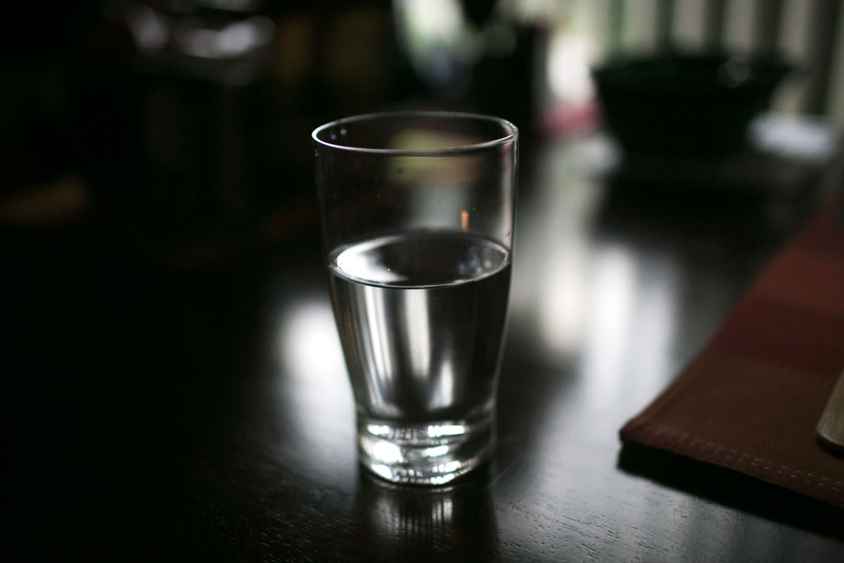 A glass of filtered water sits on Ken Wamsley's kitchen table in Parkersburg, WV.