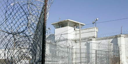 ** ADVANCE FOR SUNDAY, JAN. 27 ** A guard tower and razor wire are pictured at the  Oklahoma State Penitentiary in McAlester, Okla., Friday, Jan. 18, 2008. (AP Photo)