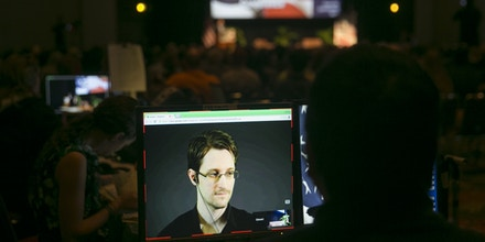 A video technician monitors a computer screen as National Security Agency leaker Edward Snowden appears on a live video feed broadcast from Moscow at an event sponsored by the ACLU Hawaii in Honolulu on Saturday, Feb. 14, 2015. (AP Photo/Marco Garcia)