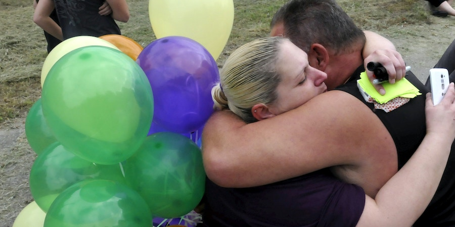Image #: 39805255    Protestors and family members embrace after hearing the news that Governor Mary Fallin issued a stay for death row inmate Richard Glossip outside the Oklahoma State Penitentiary in McAlester, Oklahoma, September 30, 2015. Oklahoma Governor Mary Fallin on Wednesday granted inmate Richard Glossip a 37-day stay of execution to give the state time to address whether its execution protocols comply with procedures approved by the federal court. Glossip, 52, was found guilty of arranging the 1997 murder of Barry Van Treese, the owner of an Oklahoma City motel that Glossip was managing. REUTERS/Nick Oxford /LANDOV