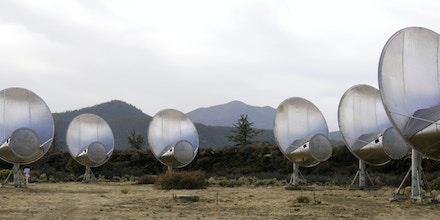 Radio telescopes of the Allen Telescope Array are seen Tuesday, Oct. 9, 2007, in Hat Creek, Calif. The search for intelligent life out there is getting a big boost with a powerful new telescope sweeping the skies for data, including any echoes of distant civilizations that may be scattered among the stars. Scientists have high hopes for the Allen Telescope Array, named after donor and Microsoft cofounder Paul G. Allen, because of its ability to collect big chunks of information and process them quickly. (AP Photo/Ben Margot)