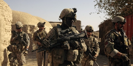 U.S. Army and special operations forces patrol Shewan, a former Taliban stronghold in Afghanistan's Farah province, Tuesday Nov. 3, 2009. (AP Photo/Maya Alleruzzo)