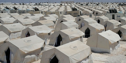 Syrian refugees wander around a refugee camp in Suruc, on the Turkey-Syria border, Friday, June 19, 2015. Ahead of World Refugee Day on Saturday, June 20, 2015, the UN refugee agency, UNHCR, estimated that a total of 11.6 million people from Syria had been displaced by the conflict by the end of last year, the largest such figure worldwide. Turkey is the world's biggest refugee host with 1.59 million refugees, according to the most recent U.N. figures. (AP Photo/Emrah Gurel)