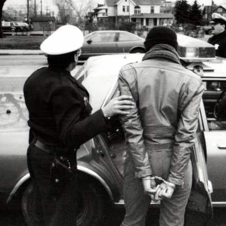 Jan. 29, 1990 - Michigan, U.S. - Officer John Jenkins arrests a women. Public perception of police has gradually become more positve, a former Detroit police commissioner said. (Credit Image: © Detroit Free Press via ZUMA Wire)