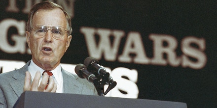U.S. President George H. Bush addresses the 91st annual convention of the Veterans of Foreign Wars in Baltimore, Monday, August 20, 1990. Bush declared for the first time that 3,000 Americans trapped in Iraq and Kuwait are hostages, and he will