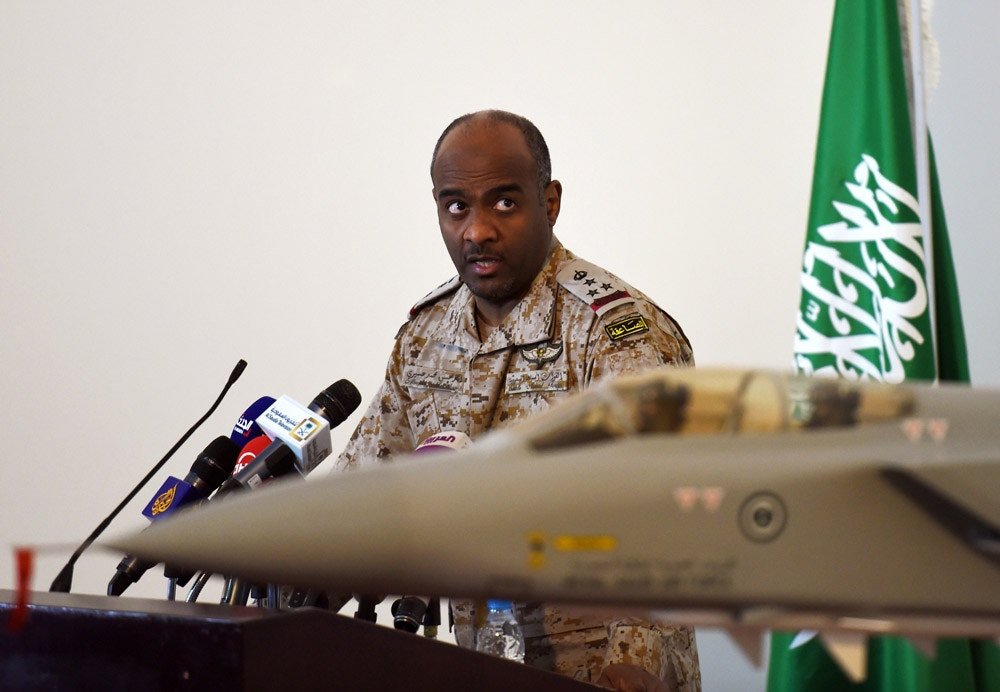 Saudi Brigadier General Ahmed Asiri, spokesman of the Saudi-led coalition forces, speaks to the media next to a replica of a Tornado fighter jet, at the Riyadh airbase in the Saudi capital on March 26, 2014. Speaking to reporters in the Saudi capital, spokesman Ahmed Assiri also said that there were no immediate plans for a ground offensive but that the coalition would not allow any supplies to reach the rebels. AFP PHOTO / FAYEZ NURELDINE        (Photo credit should read FAYEZ NURELDINE/AFP/Getty Images)