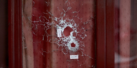 Bullet holes and marks are seen on the window of 'Le Carillon''restaurant on November 14, 2015 in Paris, France. At least 120 people have been killed and over 200 injured, 80 of which seriously, following a series of terrorist attacks in the French capital. (Photo by Pierre Suu/Getty Images)