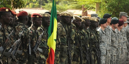 Republic of Mali and United States Special Operations Forces troops stand in formation next to each other during the opening ceremony of the Flintlock 10 Exercise held May 3, 2010 in Bamako, Mali. Flintlock 10 is a special operations forces exercise focused on military interoperability and capacity-building and is part of an AFRICOM-sponsored annual exercise program with partner nations in Northern and Western Africa.  The exercise, which includes participation of key European nations, is conducted by Special Operations Command Africa and designed to build relationships and develop capacity among security forces throughout the Trans-Saharan region of Africa.  Approximately 1,200 European, African Partner Nation and U.S. participants from 14 nations are involved in military interoperability activities across the Trans-Saharan region during this event.