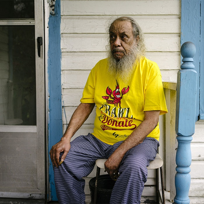 Allen LeBlanc sits on his front porch in Mossville, La., Oct. 22, 2015.