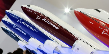 --FILE--Models of Boeing passenger jets are on display during the 16th Beijing International Aviation Expo in Beijing, China, 16 September 2015.Boeing said Wednesday (23 September 2015) that Chinese companies have agreed to buy 300 jets and build an aircraft assembly plant in China. The deals, worth about $38 billion, were signed during Chinese President Xi Jinping's visit to the United States. China Aviation Supplies Holding Company, ICBC Financial Leasing and China Development Bank Leasing inked the jet purchase agreement after Xi's arrival in Seattle. Boeing said the orders were mostly for its 737 models. The state-owned Commercial Aircraft Corporation of China on Tuesday also inked a deal with Boeing to set up a