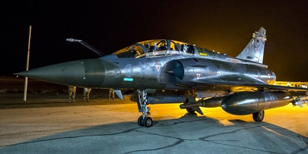 This photo released on Monday, Nov. 9, 2015 by the French Army Communications Audiovisual office (ECPAD) shows a French army Mirage 2000 jet on the tarmac of an undisclosed air base as part of France's Operation Chammal launched in September 2015 in support of the US-led coalition against Islamic State group. France's defense ministry says that a French airstrike has targeted an oil center controlled by Islamic State's militants in Syria as part of a strategy to cut off the group's funding resources. The two-hour operation conducted on Sunday near Deir ez-Zor, in the East of Syria, involved two fighter jets based in Jordan, the ministry detailed in a written statement. (French Air Force/ECPAD via AP) THIS IMAGE MAY ONLY BE USED FOR 30 DAYS FROM TIME TRANSMISSION.