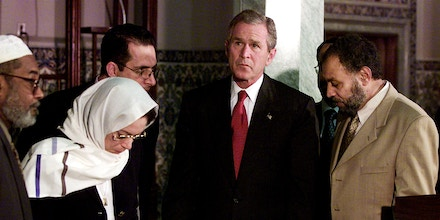President George W. Bush stands with Farzad Darui, right, manager of the Islamic Center of Washington, Azizah Alhebry, second from left, Professor at the T.C. Williams School of Law at the University of Richmond, and other Islamic leaders during a visit to the center, Monday, Sept. 17, 2001, in Washington, D.C.  President Bush is trying to put an end to rising anti-Muslim sentiment in the wake of last week's terrorist attacks.  (AP Photo/Doug Mills)