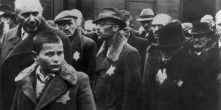 May 1944: Jewish deportees, with the yellow stars sewn on their coats, arrive at Auschwitz concentration camp.   (Photo by Hulton Archive/Getty Images)