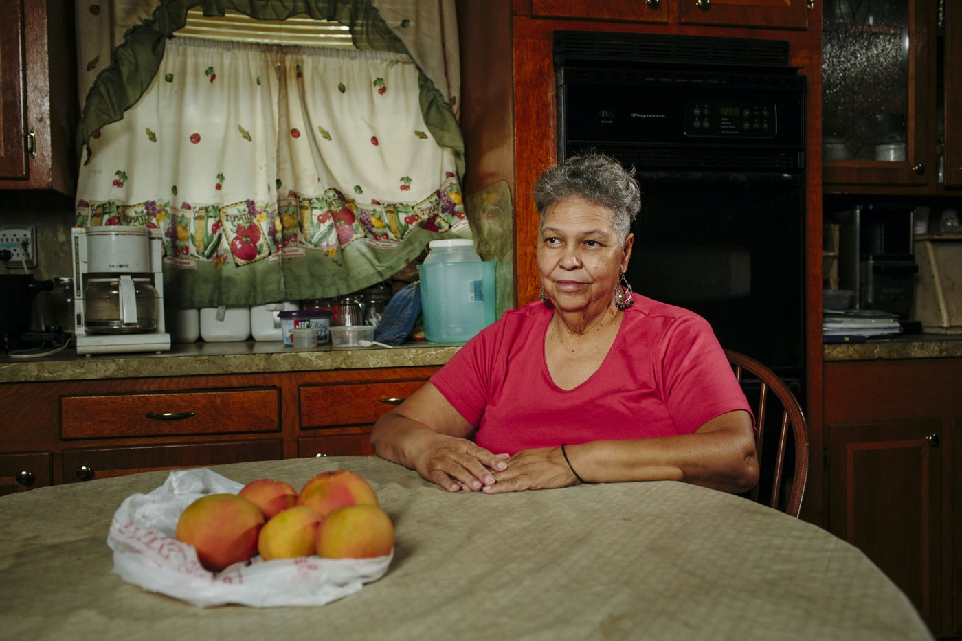 Westlake, LA - 10/22/2015 - Judy Montgomery (65) sits in her kitchen in Mossville. Montgomery has lived her entire life in the small hamlet, which has gradually been eroded by the expansion of neighboring industrial plants.