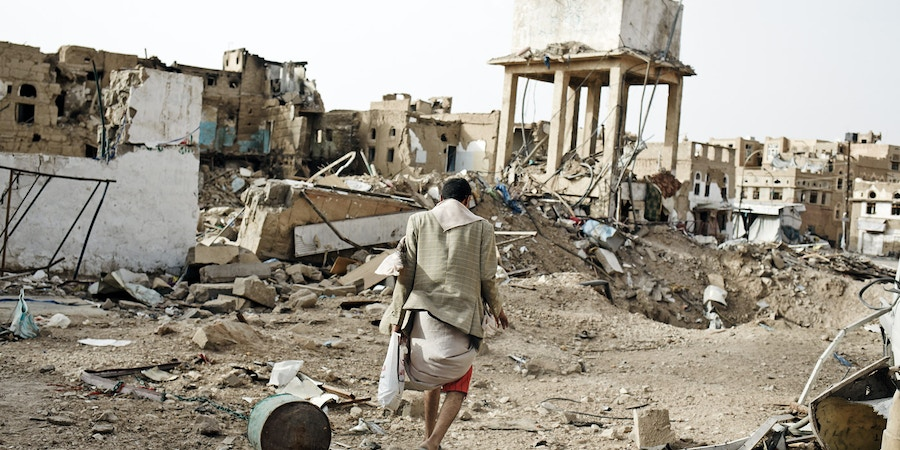 SADAH, YEMEN - JUNE 15:  Civilians walk through the destroyed city of Sadah, Yemen, on June 15, 2015. The Arab coalition has been carrying out air strikes on a daily basis in Sadah, a bastion of Houthi rebels, and warned all civilians to leave the restive province after declaring the entire territory a