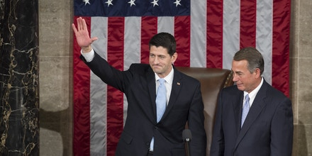 Newly elected Speaker of the House Paul Ryan, Republican of Wisconsin, waves alongside outside Speaker John Boehner, Republican of Ohio, after being elected Speaker in the House Chamber at the US Capitol in Washington, DC, October 29, 2015. AFP PHOTO / SAUL LOEB        (Photo credit should read SAUL LOEB/AFP/Getty Images)