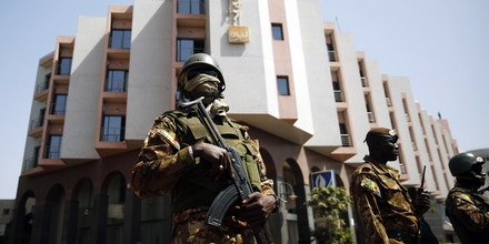Tight security surrounds Malian  President Ibrahim Boubacar Keita as he visits the Radisson Blu hotel in Bamako, Mali, Saturday, Nov. 21, 2015. Malian security forces were hunting