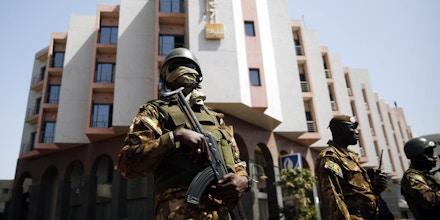 Tight security surrounds Malian  President Ibrahim Boubacar Keita as he visits the Radisson Blu hotel in Bamako, Mali, Saturday, Nov. 21, 2015. Malian security forces were hunting