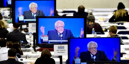 Image #: 41523757    U.S. Democratic presidential candidate Bernie Sanders appears on television screens in the media work-room during the Democratic presidential candidates debate at Saint Anselm College in Manchester, New Hampshire December 19, 2015.      REUTERS/Gretchen Ertl /LANDOV       TPX IMAGES OF THE DAY
