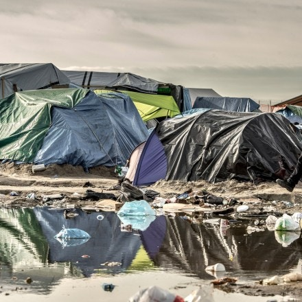 A man walks past tents on November 5, 2015 in the