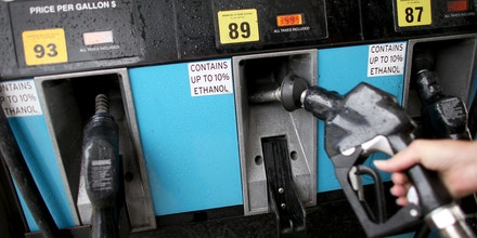 PEMBROKE PINES, FL - NOVEMBER 15:  Gas pumps with a sign indicating the gas is containing up to 10 % ethanol are seen at Victory gas station on November 15, 2013 in Pembroke Pines, Florida. Today, the federal Environmental Protection Agency announced a proposal to ease an annual requirement for ethanol in gasoline.  (Photo by Joe Raedle/Getty Images)