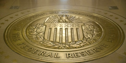The Board of Governors of the Federal Reserve seal is displayed on the floor outside the board room in Washington, D.C., U.S., on Monday, Nov. 30, 2015. The Federal Reserve took the final step to ensure it can't repeat the extraordinary steps taken to rescue American International Group Inc. and Bear Stearns Cos. in 2008, adopting formal restrictions on its ability to help failing financial firms. Photographer: Andrew Harrer/Bloomberg via Getty Images