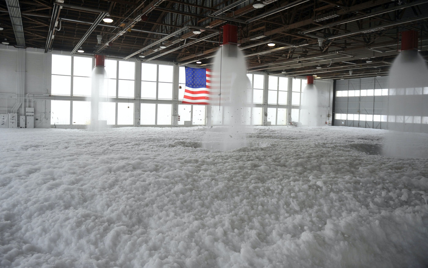 Aqueous Film Forming Foam, or AFFF, fills Hangar 211 Dec. 21, 2012, at Mountain Home Air Force Base, Idaho. Personnel from the 366th Civil Engineer Squadron performed the test to ensure aircraft maintainers who work inside this hangar will have a safe place to perform their operations – in the event of a fire the system will protect the Airmen and equipment. (U.S. Air Force photo/Senior Airman Heather Hayward/Released)