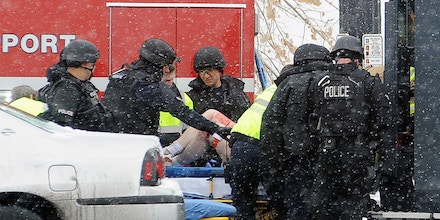 A person is transported to an ambulance Friday, Nov. 27, 2015, in Colorado Springs, Colo. A gunman opened fire at a Planned Parenthood clinic on Friday, authorities said, wounding multiple people. (Daniel Owen/The Gazette via AP) MAGS OUT; MANDATORY CREDIT