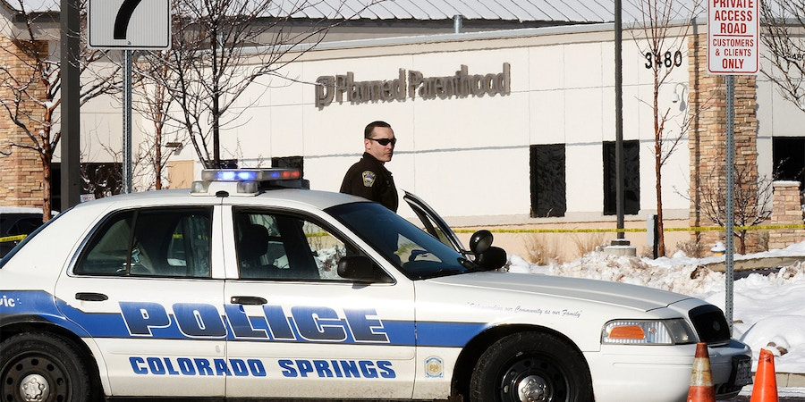 COLORADO SPRINGS, CO - NOVEMBER 30: A Colorado Springs Police officer guards the entrance to a Planned Parenthood facility in Colorado Spring where authorities continue to process the crime scene, November 30, 2015. A gunmen killed three people at  Planned Parenthood facility last Friday. (Photo by RJ Sangosti/The Denver Post via Getty Images)