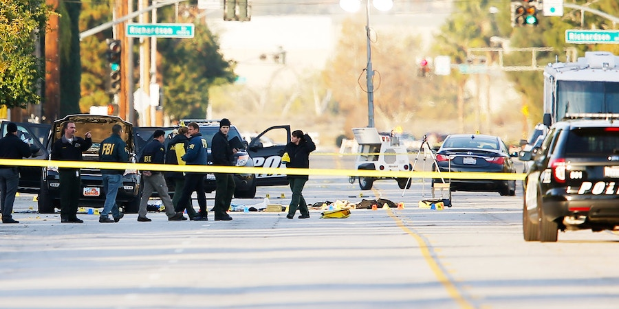 Image #: 41251069    FBI and police investigator are seen around a vehicle in which two suspects were shot following a mass shooting in San Bernardino, California December 3, 2015. Authorities on Thursday were working to determine why Syed Rizwan Farook, 28, and Tashfeen Malik, 27, who had a 6-month-old daughter together, opened fire at a holiday party of his co-workers in Southern California, killing 14 people and wounding 17 in an attack that appeared to have been planned.   REUTERS/Mike Blake /LANDOV