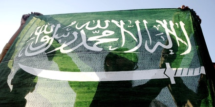 Image #: 35890612    epa04687793 Supporters of banned Islamic charity Jamatud Dawa hold a Saudi flag as they shout slogans during a rally to support Saudi-led military operation in Yemen, in Karachi, Pakistan, 31 March 2015. A Pakistani delegation left for Saudi Arabia 31 March, to discuss the crisis in Yemen and Saudi request for deployment of Pakistani troops. Pakistani Defence Minister Khawaja Asif led the delegation which included foreign affairs advisor Sartaj Aziz and other officials. The Saudi government approached Pakistan last week to provide troops in support of its operation in Yemen.  EPA/SHAHZAIB AKBER /LANDOV