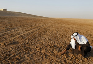 Image #: 12534326    Sheikh Ghazi Rashad Hrimis touches dried earth in the parched region of Raqqa province in eastern Syria, November 11, 2010. Lack of rain and mismanagement of the land and water resources have forced up to half of million people to flee the region in one of Syriaís largest internal migrations since France and Britain carved the country out of the former Ottoman Empire in 1920.   REUTERS/Khaled al-Hariri /Landov