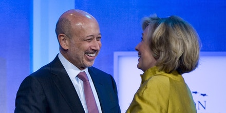 Lloyd Blankfein, Chairman & CEO, Goldman Sachs (L) greets former US Secretary of State Hillary Clinton during the 2014 Clinton Global Initiative annual meeting in New York September 24, 2014. AFP PHOTO/STEPHEN CHERNIN        (Photo credit should read STEPHEN CHERNIN/AFP/Getty Images)