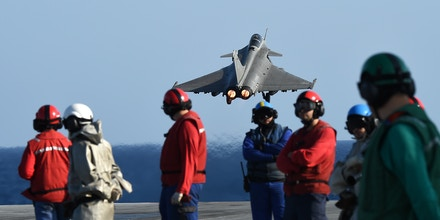 A French Rafale fighter aircraft takes off with bombs from the French aircraft carrier Charles-de-Gaulle, on November 23, 2015 at eastern Mediterranean sea, as part of operation Chammal in Syria and Iraq against the Islamic State (IS) group. AFP PHOTO / ANNE-CHRISTINE POUJOULAT / AFP / ANNE-CHRISTINE POUJOULAT        (Photo credit should read ANNE-CHRISTINE POUJOULAT/AFP/Getty Images)