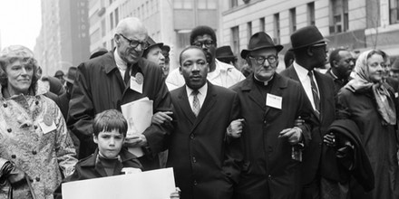 NEW YORK, UNITED STATES:  Civil rights leader Rev. Martin Luther King, Jr., (C) is accompanied by famed pediatrician Dr. Benjamin Spock (2nd-L), Father Frederick Reed (3rd-R) and union leader Cleveland Robinson (2nd-R) 16 March, 1967, during an anti-Vietnam War demonstration in New York. The US is celebrating in 2004 what would have been King's 75th birthday. King was assassinated on 04 April, 1968, in Memphis, Tennessee. AFP PHOTO (Photo credit should read AFP/AFP/Getty Images)