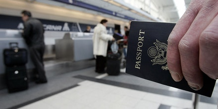 Chicago, UNITED STATES:  A passenger waits in line with his passport 23 January, 2007 before his Mexicana Air flight out of Chicago O'Hare International airport in Chicago, Illinois. As of 23 January, all Americans, Mexicans, Canadians and Bermudians traveling by air to the United States must for the first time carry a passport, said the Department of Homeland Security. The new measure is part of the department's Western Hemisphere Travel Initiative, following the recommendations of the National Commission on Terrorist Attacks on the United States, better known as the 9/11 Commission. It is aimed at making it more difficult for terrorists to enter the country with fake documents.  AFP PHOTO/JEFF HAYNES  (Photo credit should read JEFF HAYNES/AFP/Getty Images)